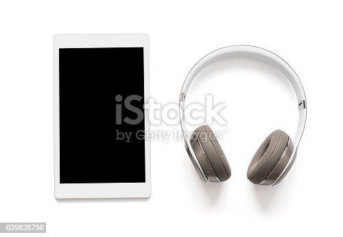 istock Headphones and tablet isolated on white 639838756
