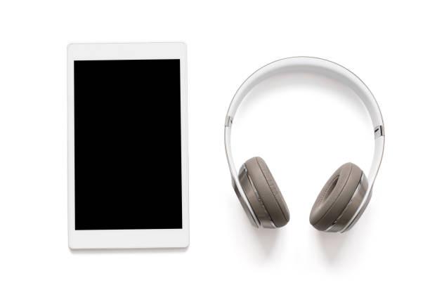 headphones and tablet isolated on white - geräusche app stock-fotos und bilder