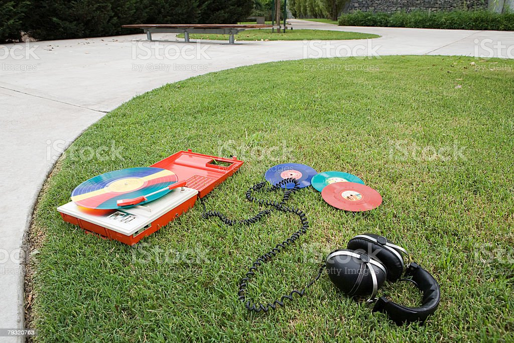Headphones and turntable on grass 免版稅 stock photo