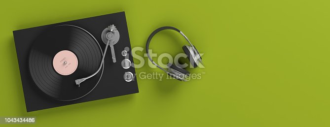 istock Headphones and vinyl LP record player on bright green background, banner, copy space. 3d illustration 1043434486