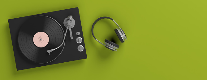 Music, sound. Headphones and vinyl LP record player on bright green background, banner, copy space. 3d illustration