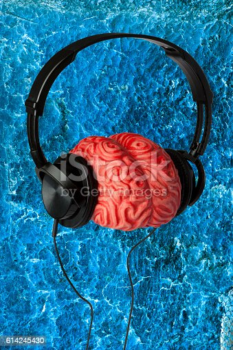 istock Headphones, Brain and a Blue Background 614245430