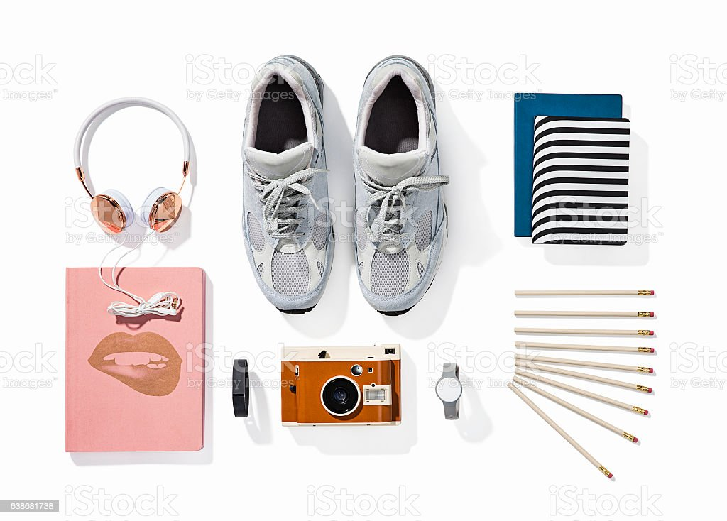 Headphones, camera, shoes, watch, notepads and pens stock photo