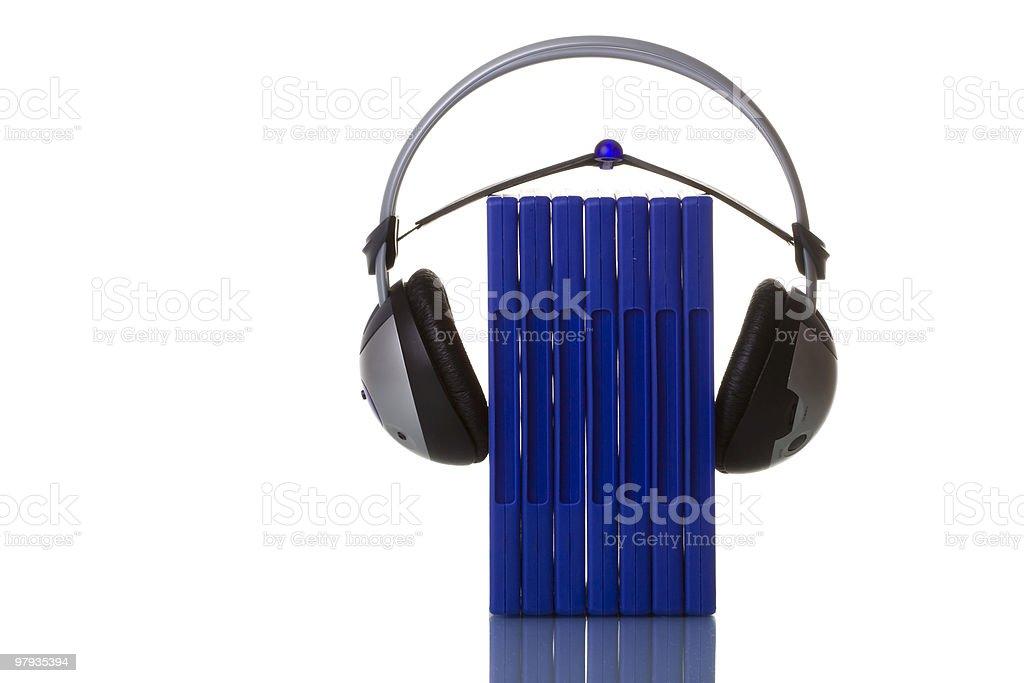 headphones holding blue cases royalty-free stock photo
