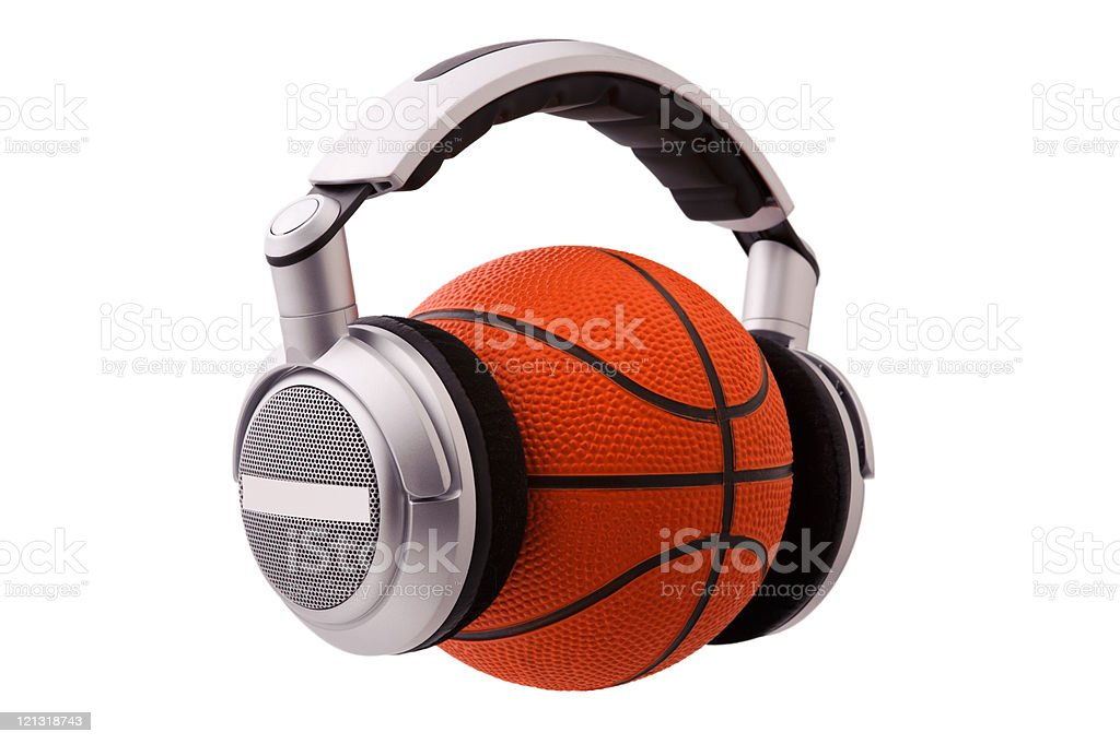 Headphones on a basketball ball, sport and music concept stock photo