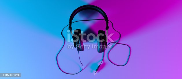 headphones on a black background close-up in neon light, 3d illustration
