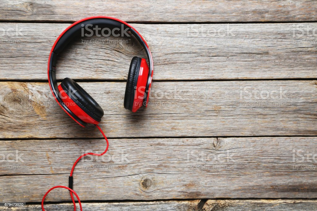Headphones on a grey wooden table, close up royalty-free stock photo