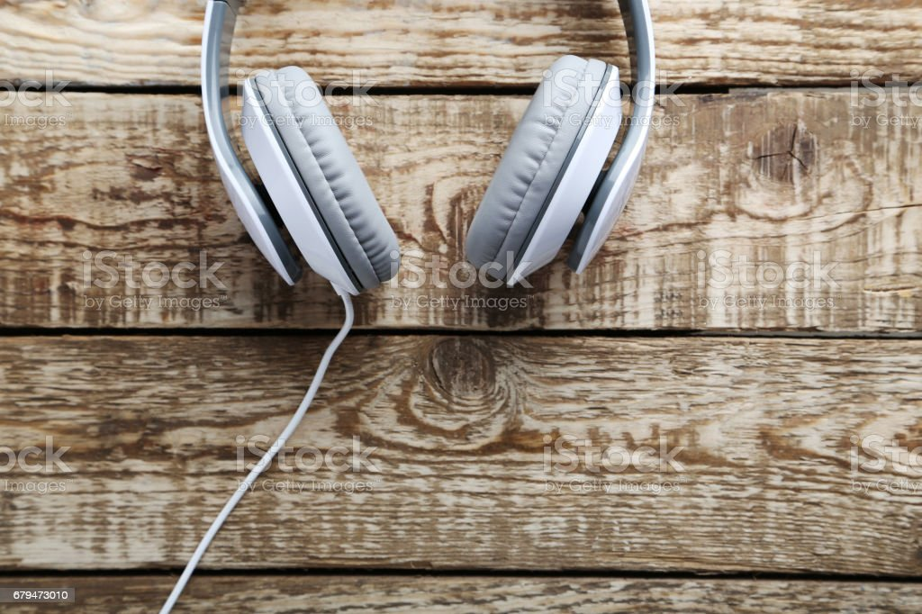 Headphones on a grey wooden table royalty-free stock photo