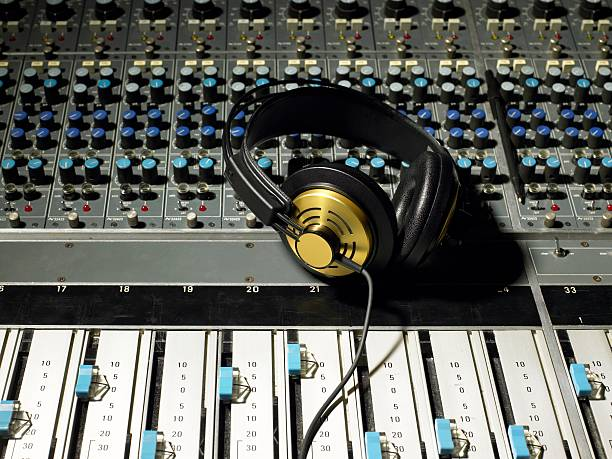 Headphones on a mixing desk  sound mixer stock pictures, royalty-free photos & images