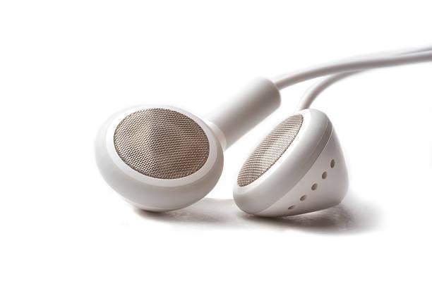 casque sur fond blanc - écouteurs intra auriculaires photos et images de collection