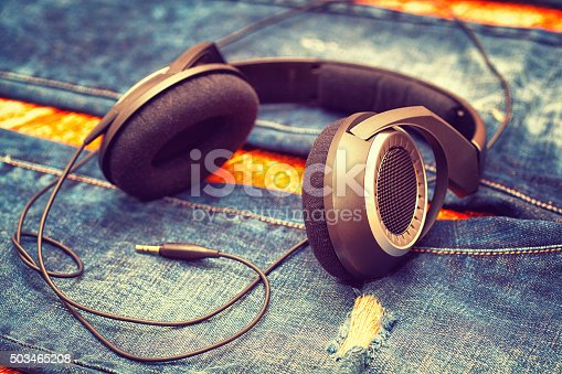 headphones on background of denim