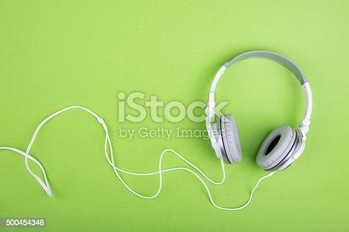 istock Headphones on green background 500454346