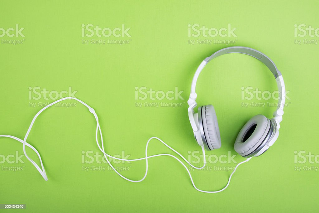 Headphones on green background stock photo