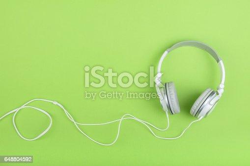 istock Headphones on green background 648804592