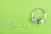 Headphones on green background