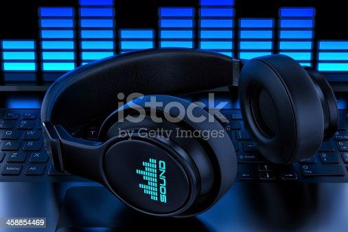 istock Headphones on laptop. Recording audio 458854469