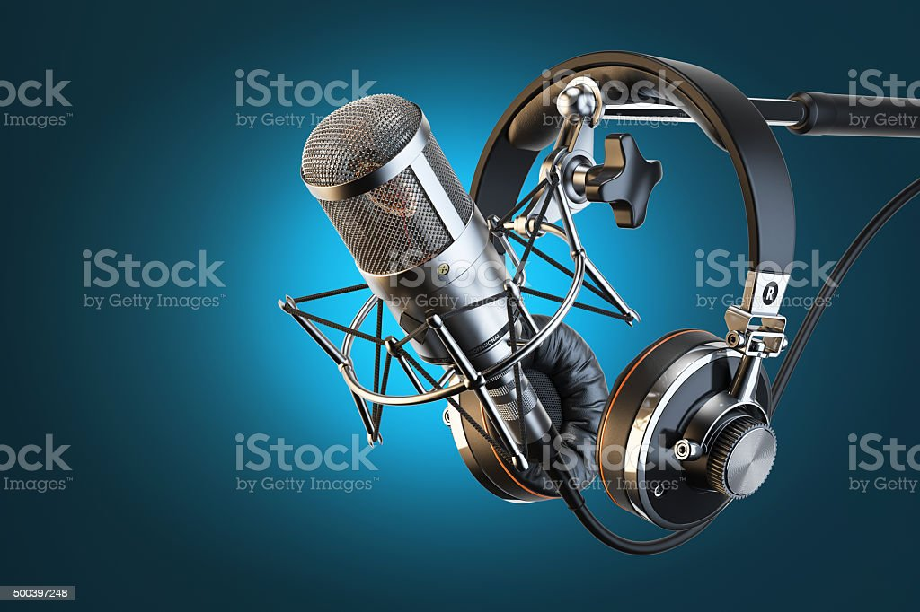 Headphones on microphone stand, professional studio stock photo
