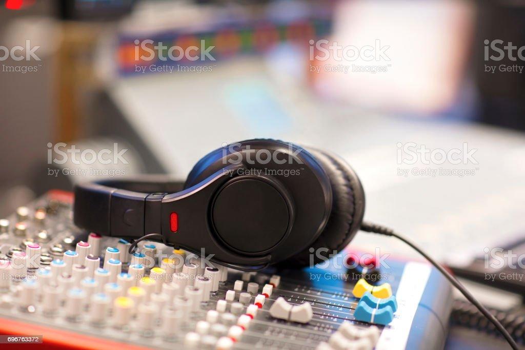 Headphones on Mixer Cord In Radio Studio stock photo