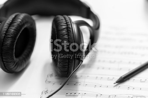 Headphones on musical synthesizer keyboard. Headphones on electronic piano. Musical background