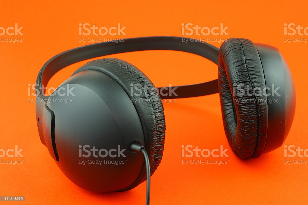 Headphones on red background stock photo