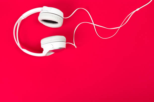 headphones on red surface headphones on red surface mp3 player stock pictures, royalty-free photos & images