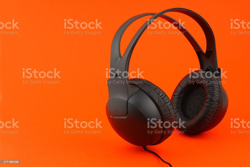 Headphones on red with copy space stock photo