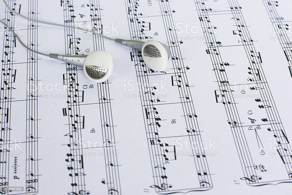 Headphones on Sheet Music royalty-free stock photo