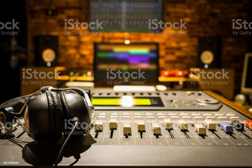 headphones on sound mixer in digital recording studio stock photo