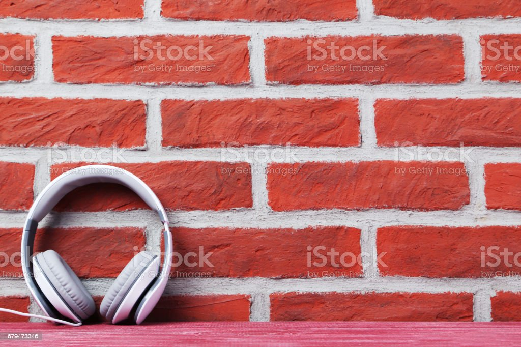 Headphones on the brick wall background royalty-free stock photo