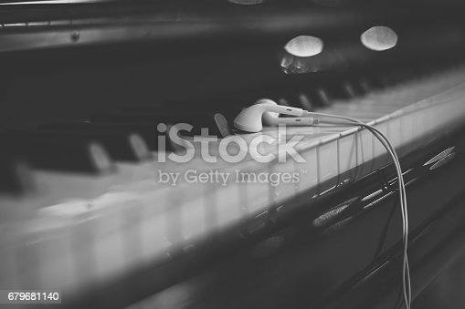 istock Headphones on the piano keyboard 679681140