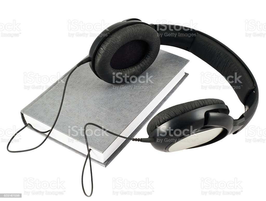 Headphones over a book composition stock photo