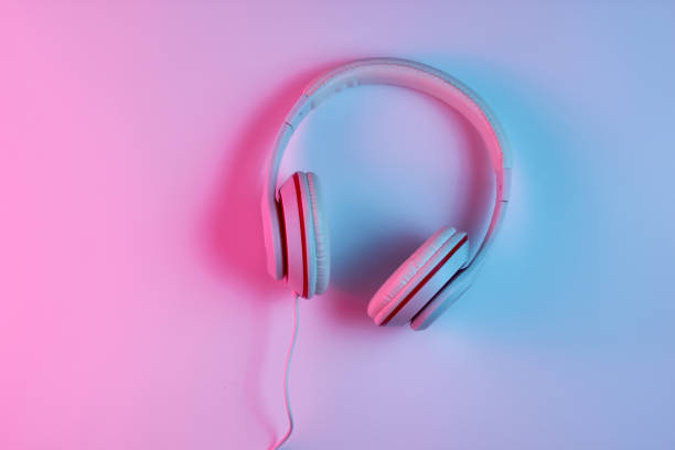 Headphones Classic wired headphones with gradient blue pink neon light. Retro style.Retro wave. 80s. Minimalistic music concept. Top view mp3 player stock pictures, royalty-free photos & images