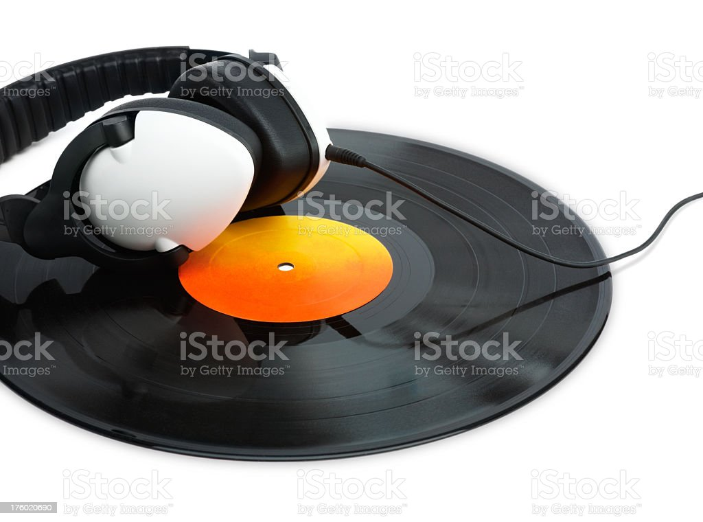 Headphones placed over a vinyl record royalty-free stock photo
