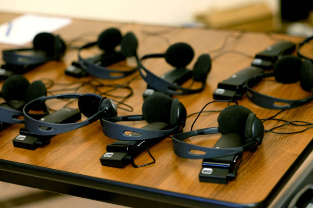 headphones used for simultaneous translation equipment - translator stock photos and pictures