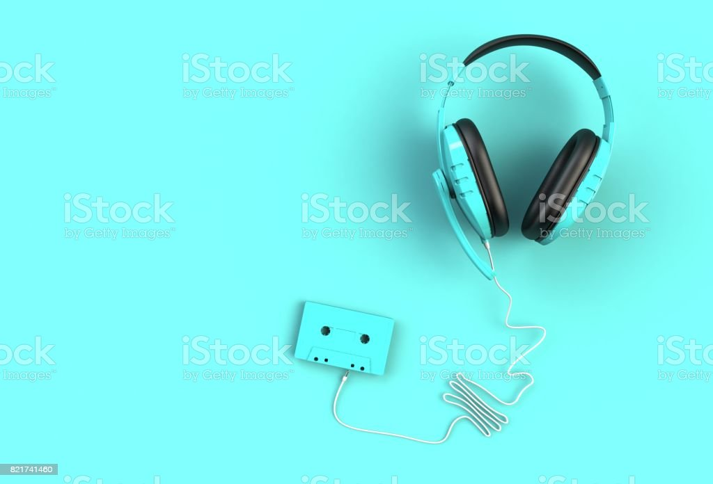 Headphones with cassette tape on blue background, Top view with copyspace for your text, 3D rendering stock photo