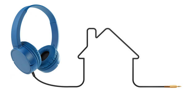 Headphones with house shaped cable on white stock photo