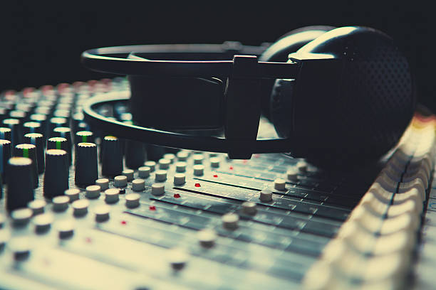 Headpnones on soundmixer Headpnones on soundmixer electric mixer stock pictures, royalty-free photos & images