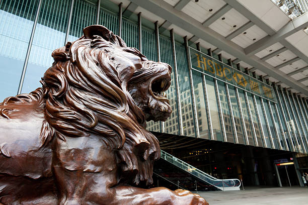 Headquarter of HSBC in Hong Kong Hong Kong, China - January, 29 2011: Lion sculpture in front of Headquarter of HSBC in Hong Kong. hsbc stock pictures, royalty-free photos & images