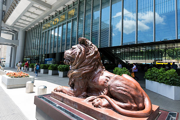Headquarter of HSBC in Hong Kong Hong Kong, Hong Kong SAR - June 4 2015: HSBC lion near the headquarters building of The Hongkong and Shanghai Banking Corporation in Central on June 4 2015. HSBC holding is the main bank in Hong Kong hsbc stock pictures, royalty-free photos & images