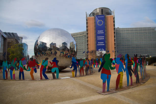 EU headquarters in Brussels Sculpture by Cristobal Gabarron celebrating the 70th anniversary of the Universal Declaration of Human Rights in the middle of Schuman roundabout, in front of the EU headquarters in Berlaymont palace - European Commission building. european commission stock pictures, royalty-free photos & images