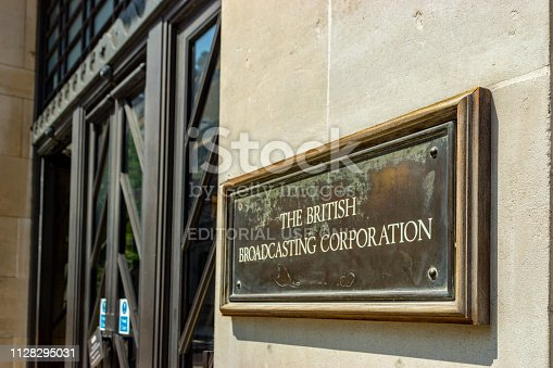London, UK - This is the front of the BBC's Broadcasting House building in central London, with the iconic brass name plate beside the door.