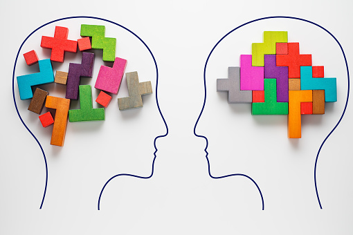 istock Heads of two people with colourful shapes of abstract brain 882484258