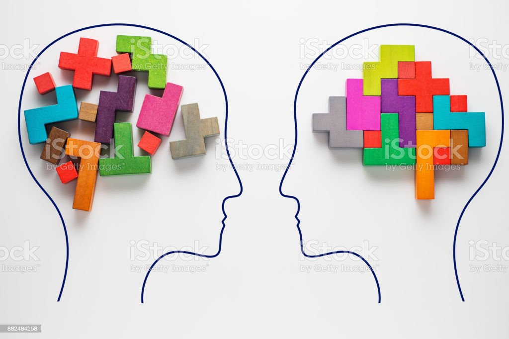 Heads of two people with colourful shapes of abstract brain stock photo
