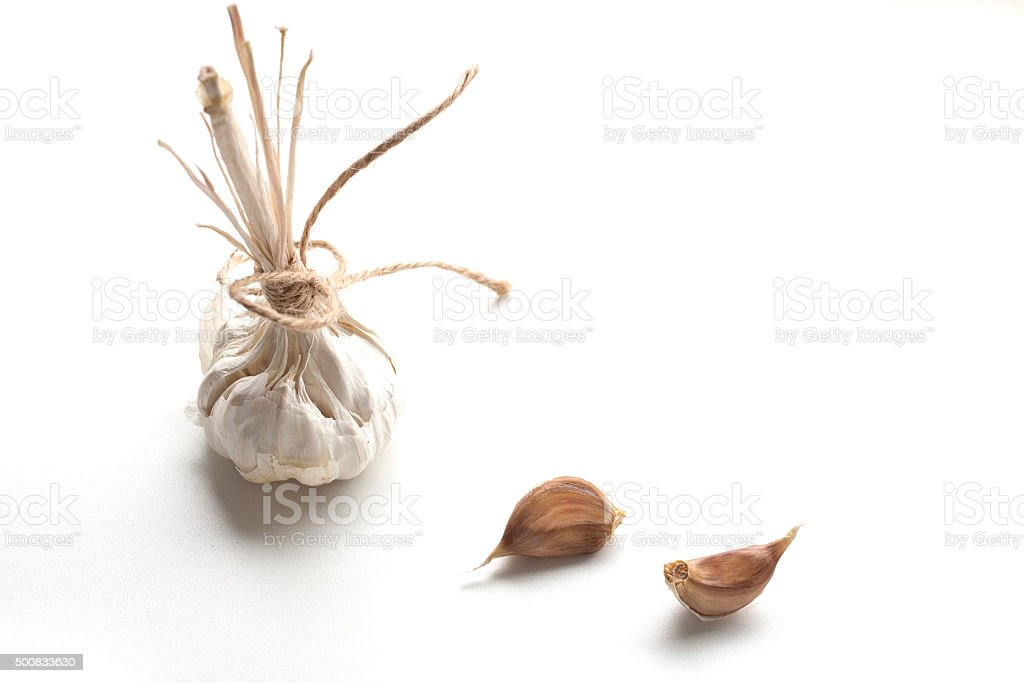 Heads of young and mature garlic royalty-free stock photo