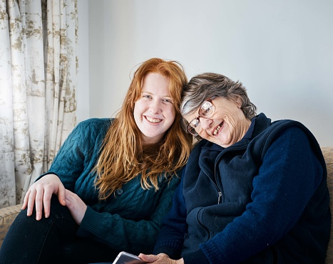 144362548 istock photo Heads together, grandmother and granddaughter smile affectionately 1001409812