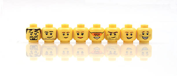 heads up - row of heads stock photos and pictures