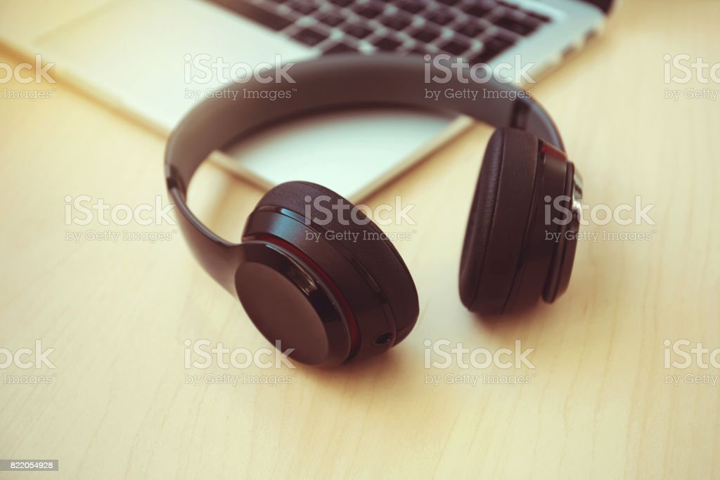 Headset on a laptop computer stock photo