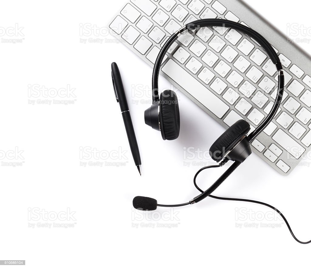 Headset, pen and keyboard stock photo