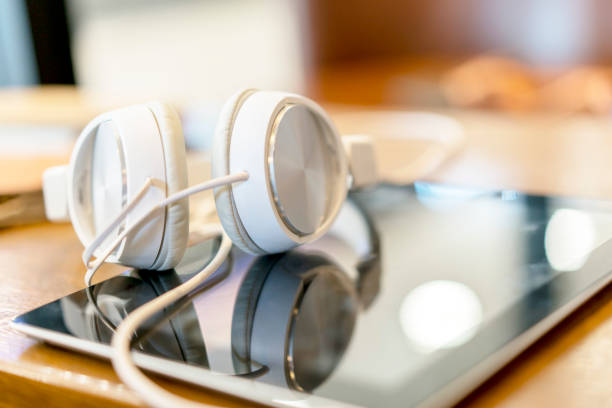 headset reflected on tablet PC screen stock photo