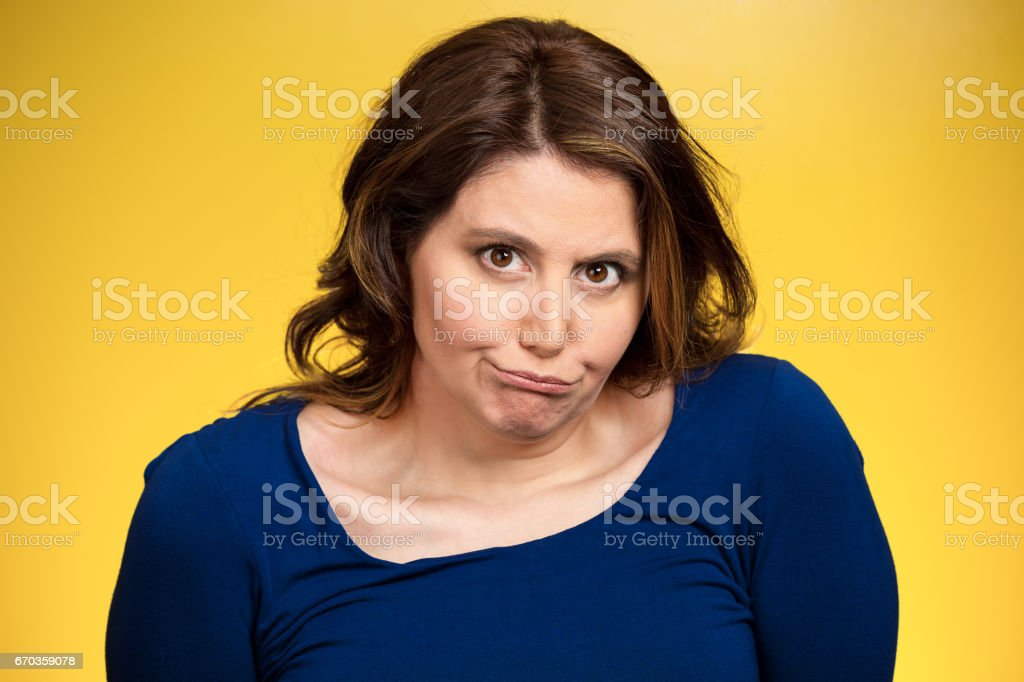 headshot displeased, pissed off, angry, grumpy middle aged woman with bad attitude stock photo